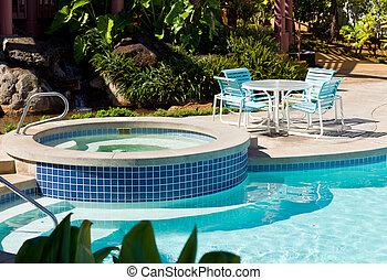 Pool and hot tub with table - Relaxing hot tub by side of...
