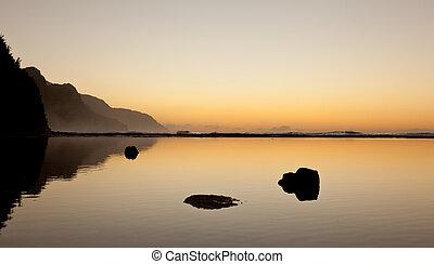 Misty sunset on Na Pali coastline - Albatros soaring over...