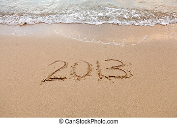 2013 written in sand with waves
