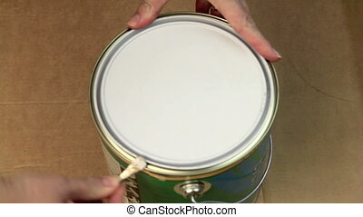 Opening A Can Of Paint - Taking the lid off a can of paint...