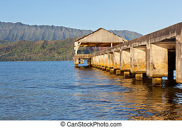 Sunrise in Hanalei Bay Kauai - Rising sun illuminates the...