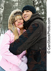 young couple in winter park - happy young couple in winter...