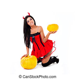 woman with pumpkins - sexy young brunette woman dressed as...