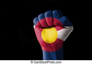 Fist painted in colors of us state of colorado flag