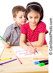 Two little kids draw for mum - Two little kids at the table...