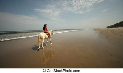 Woman Riding At Beach