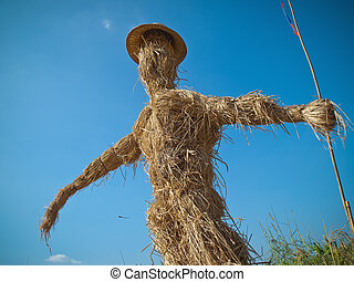Scarecrow made of straw Standing arm extended chase birds