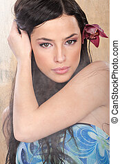 woman in tropical environment - Pretty girl with red orchid...