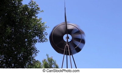 Windmill 3 - Miniature steel windmill spinning and blowing...