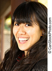 Asian woman with smiling face