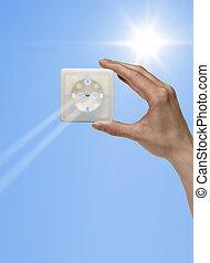 solar energy - symbolic solar energy theme showing the sun...