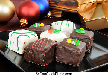 Petite Fours at Christmas - A plate of petite fours with...