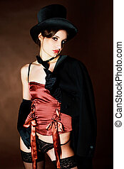 girl wearing a cylinder hat - beautiful young brunette woman...