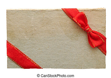 old paper sales tag and label with red ribbon and bow on...
