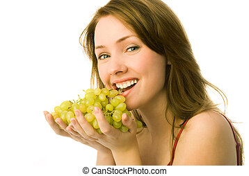 beautiful woman with grapes - portrait of a cheerful young...