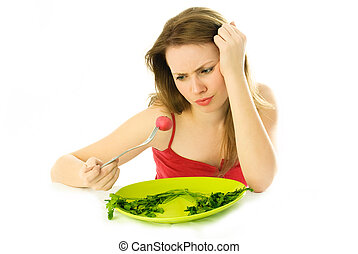 young woman keeping a diet - beautiful displeased young...