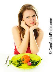 displeased woman keeping a diet - beautiful young woman...