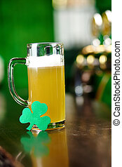 Irish beer - Image of glass of beer with shamrock leaf on...