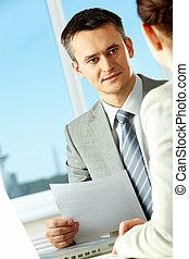 Explanation - Smart businessman explaining something to his...