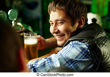 Friends at bar - Cheerful male friends spending time...