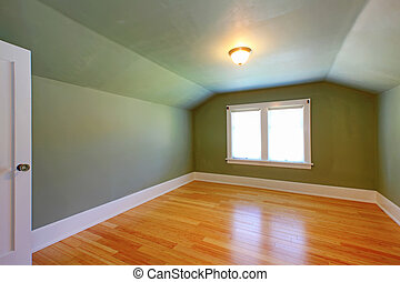 Attic green room with low ceiling and hardwood floor - Attic...