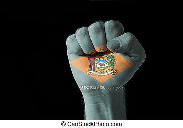 Fist painted in colors of us state of delaware flag