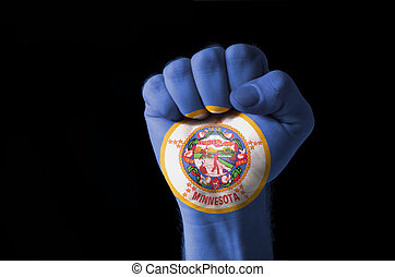 Fist painted in colors of us state of minnesota flag
