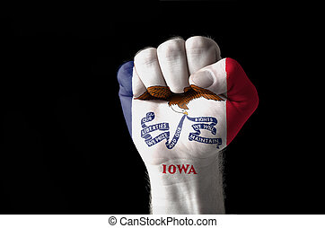 Fist painted in colors of us state of iowa flag