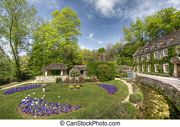 Typical Cotswolds gardens in Bibury