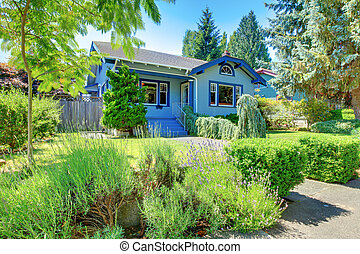 Small old cute blue craftsman one level home.