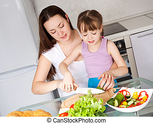 mother and daughter eat bread - young mother and her five...