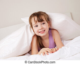 girl on the bed - cute little girl on the bed at home