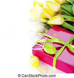 easter eggs with yellow tulip flowers and gift box isolated...