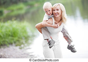 mother and son - happy family; young mother and her five...