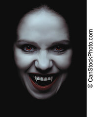 woman vampire with fangs on a black background - portrait of...