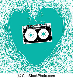 Old stereo audiocassette with tangled heart shaped magnetic...