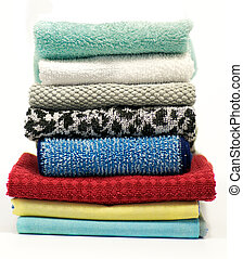 Colorful terry cloth towels isolated on white background