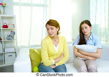 I am sorry - Photo of offended woman sitting on sofa with...