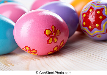 Paschal eggs - Close up of colorful Easter eggs lying on a...