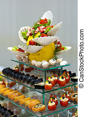 seafood catering - glass table with delicious sea food...