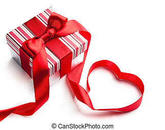 holiday gift box with red ribbon in the shape of a heart...