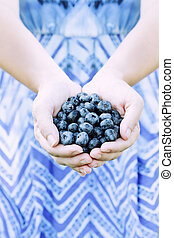 Woman Hands Offering Blueberries - Woman offers freshly...