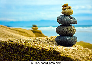 Zen Stone stacked together on blue coud background.