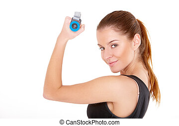 Fitness woman working out with dumbbells on white
