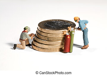 Maintaining The Euro - Miniature model workmen maintaining a...
