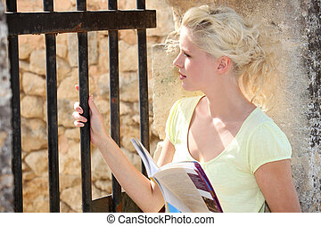 Blond woman visiting old Castle