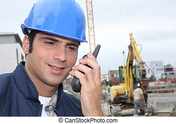 Foreman communicating via radio