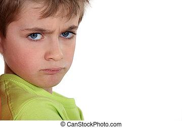 little boy sulking