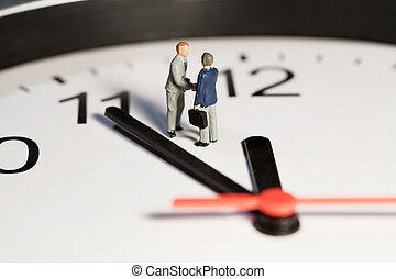 Time Is Of The Essence - Two miniature businessmen toy...