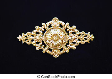 Golden blazon - Old golden blazon decoration at black